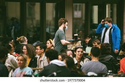Strasbourg, France - May 19, 2021: People eating drinking at the terrace of La nouvelle poste on pedestrian district as bars and restaurants reopen after two months of nationwide coronavirus outbreak