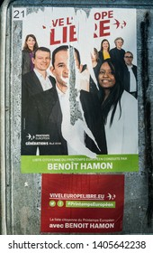 Strasbourg, France - May 23, 2019: Damaged Posters in green sunny park for 2019 European Parliament election featuring French Benoit Hamon