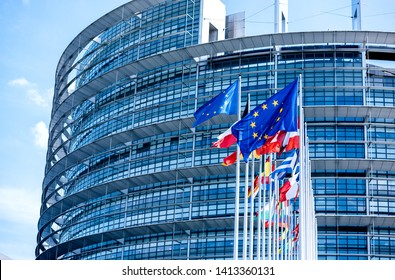 Strasbourg, france - May 26, 2019: Flags of all member states of the European Union waving in calm wind in front of the Parliament headquarter on the day of 2019 European Parliament election