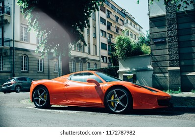 STRASBOURG, FRANCE - MAY 28, 2018: Side view of expensive luxury car of red color parked on street in sunlight Red Ferrari