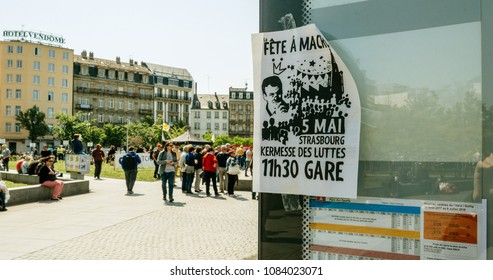 STRASBOURG, FRANCE - MAY 5, 2018: People making a party protest Fete a Macron in front of Gare de Strasbourg  poster calling to party