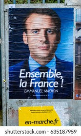 STRASBOURG, FRANCE - MAY 7, 2017: Emmanuel Macron portrait poster detail next to polling place during the second round French presidential election choose between Emmanuel Macron and Marine Le Pen