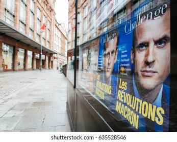 STRASBOURG, FRANCE - MAY 7, 2017: French city with Macron revolution cover magazine press kiosk with city in during second round French presidential election choose Emmanuel Macron and Marine Le Pen