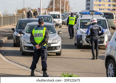 STRASBOURG, FRANCE - NOV 14 2015: French Police checking vehicles on the 'Bridge of Europe' between Strasbourg and Kehl Germany, after attacks in Paris - police inspecting every car