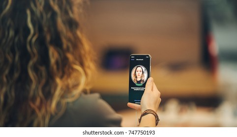 STRASBOURG, FRANCE - NOV 3, 2017: Woman trying Face ID - latest Apple iPhone X goes on sale in Apple Store worldwide