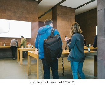STRASBOURG, FRANCE - NOV 3, 2017: Genius Team helping with purchase of the latest Apple iPhone X goes on sale in Apple Store worldwide