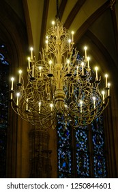 Strasbourg, France - November 26, 2017: Luxurious chandelier in the elven style, in the Strasbourg Cathedral
