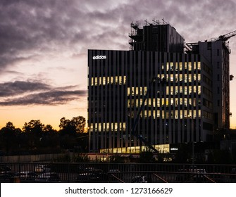 STRASBOURG, FRANCE - OCT, 25, 2018: Adidas France headquarter in Wacken business district in Strasbourg at sunset with logotype of the sport brand illuminated on the top of the building