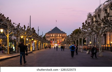 STRASBOURG, FRANCE - OCT, 25, 2018: Opera national du Rhin building as seen from place Broglie at sunset with pedestrians walking in background