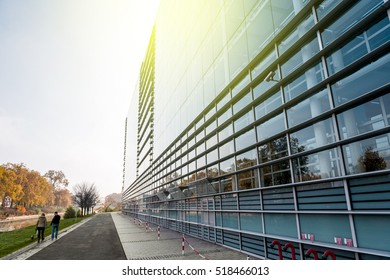 STRASBOURG, FRANCE - OCT 30, 2015: Surveillance camera on the facade of European Parliament with couple walking their dog