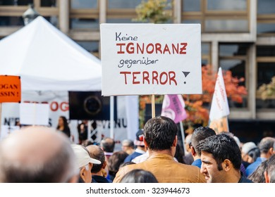 STRASBOURG, FRANCE - OCT 4, 2015 Demonstrators protesting against Turkish President Recep Tayyip Erdogan's visit to Strasbourg - keine ignoranz, gegenuber terror placard