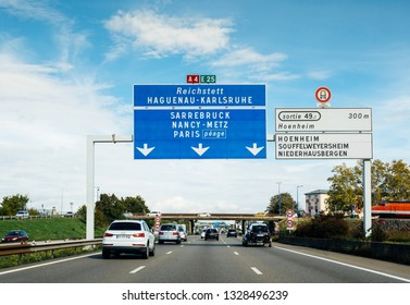 Strasbourg, France - Oct 7, 2017: Driver POV at multiple cars on A4 French highway with destination Reichstett, Hagenau, Karlsruhe, Sarrebruck, Nancy, Paris, Hoenheim Souffelweyersheim