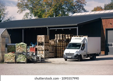 Strasbourg, France - October 18, 2017: Vegetable base (vegetable warehouse). Car microgrid waggon for delivery of vegetables and boxes of vegetable waste. Vegetable farm, olericulture