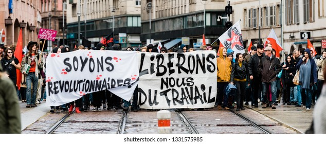 Strasbourg, France - Sep 12, 2017: let's be revolutionary message on placard at political march during a French Nationwide day of protest against the labor reforms hundreds of people on street