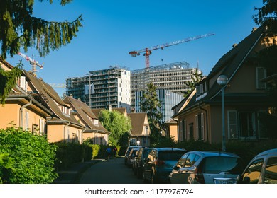 STRASBOURG, FRANCE - SEP 12, 2018: Construction of high rise skyscrapers buildings with construction crane as seen from the calm neighborhood in Strasbourg near European Parliament