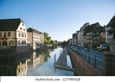 STRASBOURG, FRANCE - SEP 12, 2018: Ill river with Quai des Bateliers renowned piers perspective view early in the morning