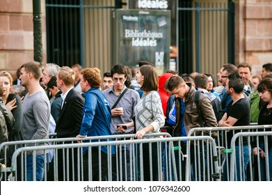 STRASBOURG, FRANCE - SEP, 19 2014: Large queue in front of Apple Store with customers waiting in line to buy the latest iPhone iPad Apple Watch and notebook
