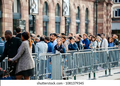 STRASBOURG, FRANCE - SEP, 19 2014: Large crowd in front of Apple Store with customers waiting in line to buy the latest iPhone iPad Apple Watch and notebook
