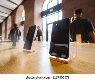 STRASBOURG, FRANCE - SEP 21, 2018: Apple Store with customers people buying admiring in the background the new latest iPhone Xs and Xs Max pre order for Xr and Watch Series 4 wearable