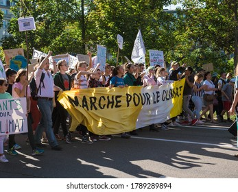 Strasbourg, France - Sep 21, 2019: Front view of large group of people climate change activists with yellow protest placard banner as main inscription Marche pour le Climat - Climate March protest