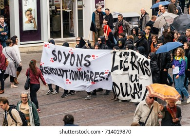 STRASBOURG, FRANCE - SEPT 12, 2017: Soyons Revolutionnaires translated as Be Revolutionary poster masked people Nationwide day protest against the labor reform proposed by Emmanuel Macron Government