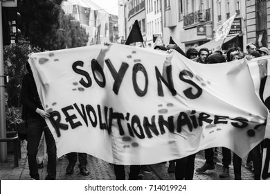 STRASBOURG, FRANCE - SEPT 12, 2017: Masked people with Soyons Revolutionnaires translated as Be Revolutionary day of protest against the labor reform proposed by Emmanuel Macron Government