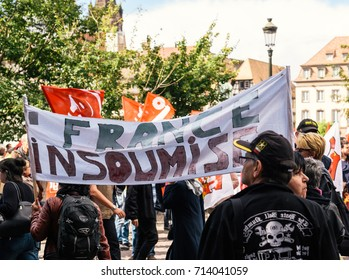 STRASBOURG, FRANCE - SEPT 12, 2017: Demonstrators with France insoumise placard at political march during a French Nationwide day of protest against labor reform proposed by Emmanuel Macron Government