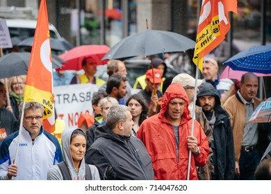 STRASBOURG, FRANCE - SEPT 12, 2017: Heavy rain over people at political march during a French Nationwide day of protest against the labor reform proposed by Emmanuel Macron Government