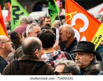 STRASBOURG, FRANCE - SEPT 12, 2017: Protester wearing Emmanuel Macron mask at political march during a French Nationwide day of protest against the labor reform proposed by Emmanuel Macron Government