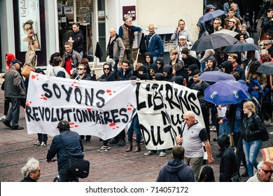 STRASBOURG, FRANCE - SEPT 12, 2017: Soyons Revolutionnaires translated as Be Revolutionary poster by incognito young people against the labor reform proposed by Emmanuel Macron Government