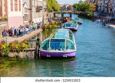 Strasbourg, France - September 09, 2018: cityscape of the Grande Ile in Strasbourg with unidentified people. The Grande Ile, between canals of the river Ill is the historic center of Strasbourg