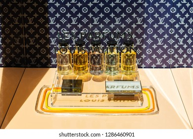 Strasbourg, France - September 09, 2018: window display with perfume at a Louis Vuitton store. Louis Vuitton is a world-famous luxury brand of mainly leatherware but also fashion and accessoires.