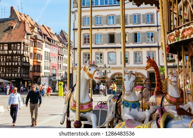 Strasbourg, France - September 09, 2018: carousel on the Place Gutenberg with unidentified people. It's located in the Grande Ile that is with the whole historic center an UNESCO World Heritage site