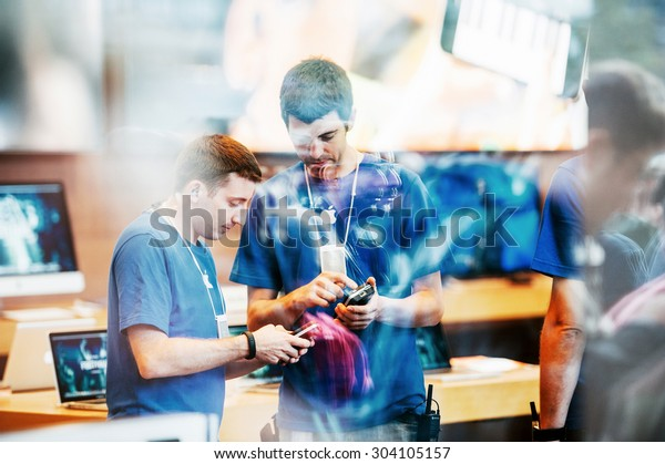 STRASBOURG, FRANCE - SEPTEMBER 19, 2014: Apple Store interior reflected with customers waiting in line outside in front the store during the sales launch of the iPhone X 8 Plus
