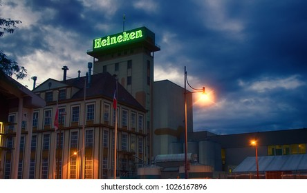 Strasbourg, France - September 19, 2017: Features of globalization. Centers of large corporations in different countries. Office Dutch brewing company Heineken in France, beer production facility