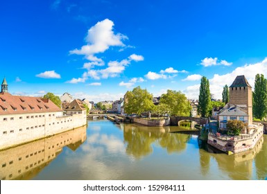 Strasbourg, towers of medieval bridge Ponts Couverts and reflection, Barrage Vauban. Alsace, France.