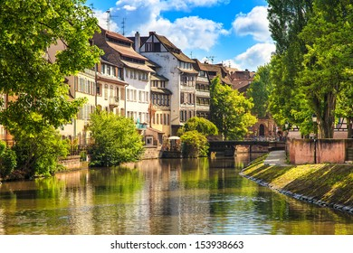 Strasbourg, water canal in Petite France area. Half timbered houses and trees in Grand Ile. Alsace, France. Unesco Site.