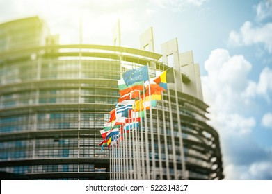 STRASBURG, FRANCE - JUN 1, 2012: Flags in front of the European Parliament, Flags in front of the European Parliament, Strasbourg, Alsace, France.  Brexit Tilt shift lens used to accent the flags