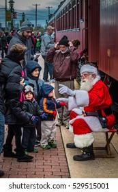 Strasburg, PA - December 3, 2016: Santa Claus speaks to some of his admirers at the Strasburg Rail Road.