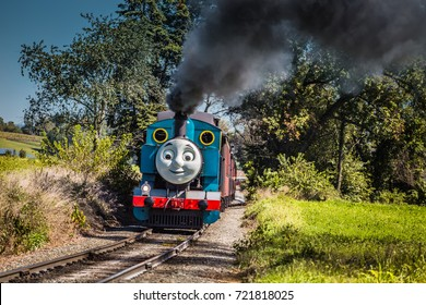 Strasburg, PA - September 23, 2017: Thomas the Tank Engine, the fictional steam locomotive from the children's books, chugs on the tracks in Lancaster County, Pennsylvania.
