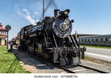 Strasburg, PA, USA - April 14, 2018:  A steam locomotive from the Strasburg Rail Road pulls into the train station in Lancaster County, PA.