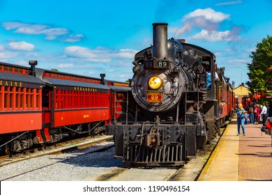 Strasburg, PA, USA - October 6, 2015: The Strasburg Rail Road steam locomotive arrives at the train station.