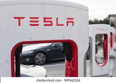 STRASBURG, VIRGINIA - DECEMBER 31, 2015: Close up of a row of Tesla Superchargers.