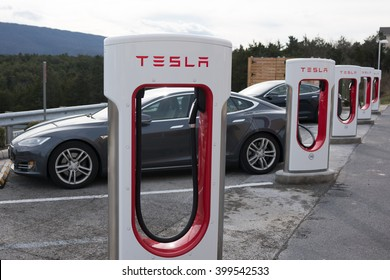 STRASBURG, VIRGINIA - DECEMBER 31, 2015: Tesla Superchargers with two Model S electric vehicles charging.