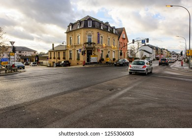 Strassen, Luxembourg - December 10, 2018: View of the traffic intersection at the corner of Route d'Arlon and Rue de Reckenthal with the Brasserie Benelux on the corner