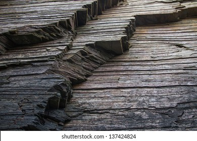 Strata, slate or shale rock layers.