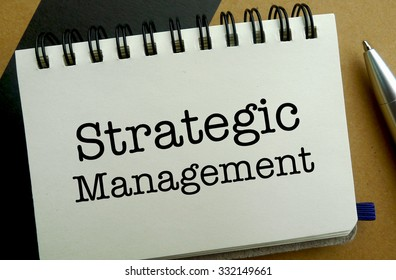 Strategic management memo written on a notebook with pen