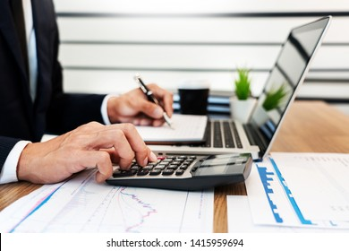 strategy analysis concept, Businessman working  financial Manager Researching Process accounting calculate analyse market graph data stock information review on the table in office