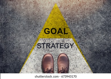 Strategy and Goal concept, Shoes stand over Triangle level Shape , Top view and Dark tone, Grunge Dirty Concrete Floor as Background