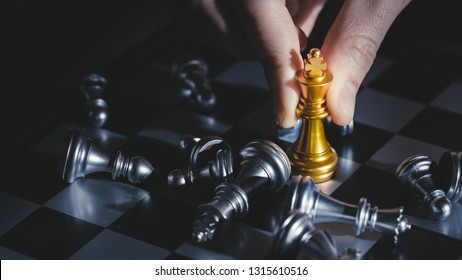 Strategy ideas concept business.Chess (King wins the game) on black background. Success,business strategy, victory.